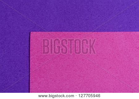 Eva foam ethylene vinyl acetate pink surface on purple sponge plush background