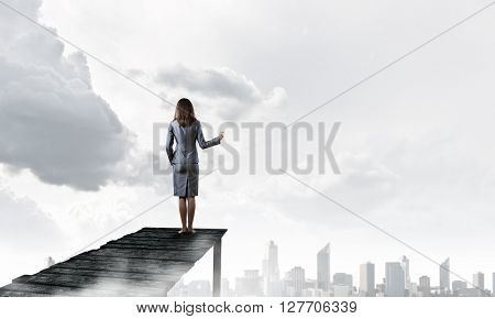 Businesswoman stand on berth