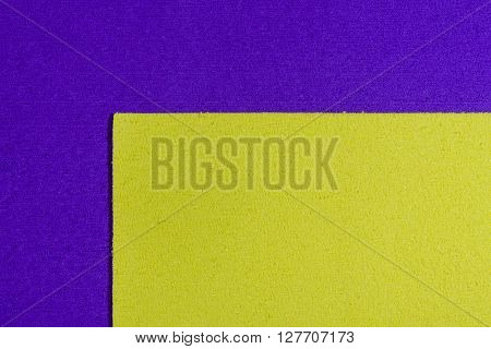 Eva foam ethylene vinyl acetate lemon yellow surface on purple sponge plush background