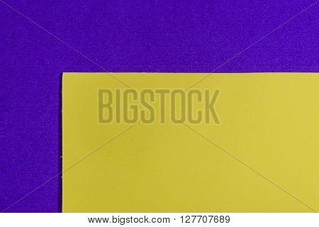 Eva foam ethylene vinyl acetate smooth lemon yellow surface on purple sponge plush background