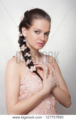 Portrait of young woman with with braids and flowers in hair
