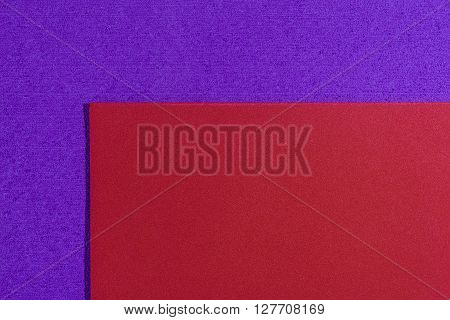 Eva foam ethylene vinyl acetate smooth red surface on purple sponge plush background