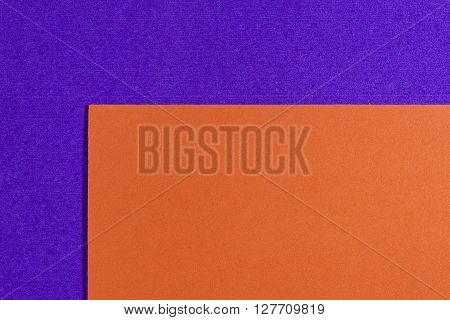 Eva foam ethylene vinyl acetate smooth orange surface on purple sponge plush background
