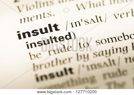 Close Up Of Old English Dictionary Page With Word Insult.