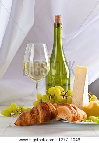 Cheese With Grapes And Croissants
