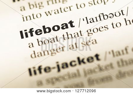 Close Up Of Old English Dictionary Page With Word Lifeboat.