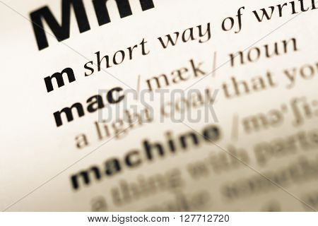 Close Up Of Old English Dictionary Page With Word M.