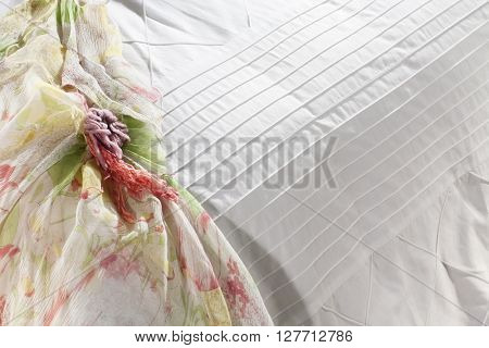 bed closeup , classy white covers , in sunny white bedroom