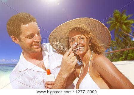 Couple sun protection on the beach.