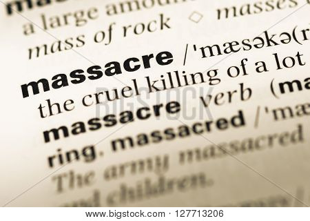 Close Up Of Old English Dictionary Page With Word Massacre.
