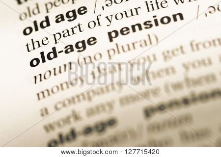 Close Up Of Old English Dictionary Page With Word Old Age Pension.