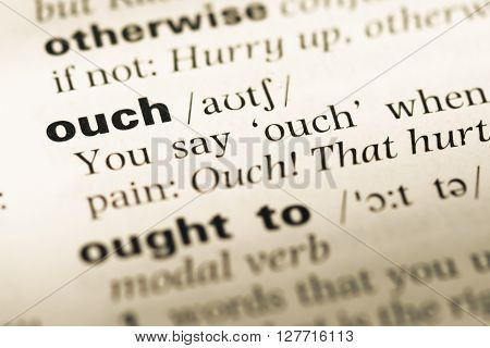Close Up Of Old English Dictionary Page With Word Ouch.