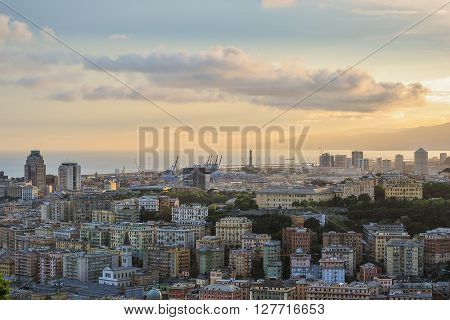 The skyline of Genoa during the sunset