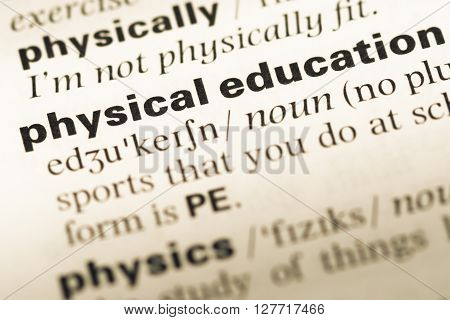 Close Up Of Old English Dictionary Page With Word Physical Education.