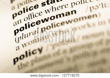 Close Up Of Old English Dictionary Page With Word Policewoman.