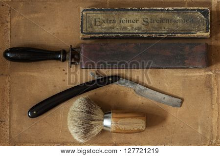 Flat Lay Of Old Shaving Tools And German Text For