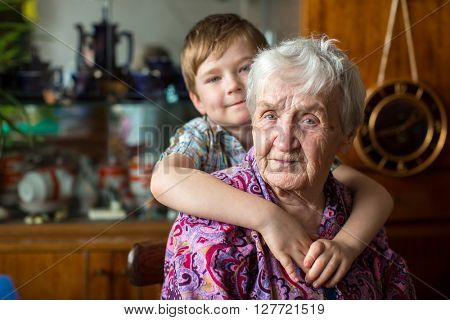 Portrait of grandmother with her grandson.