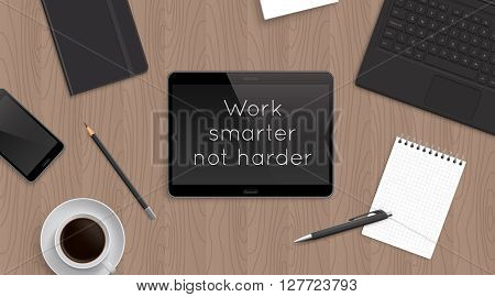 'Work smarter not harder' motivational and inspirational headline in tablet. Quote on the realistic office desktop top view with laptop, bloknot and diary and smartphone and coffee.