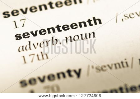 Close Up Of Old English Dictionary Page With Word Seventeenth.
