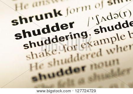 Close Up Of Old English Dictionary Page With Word Shudder.