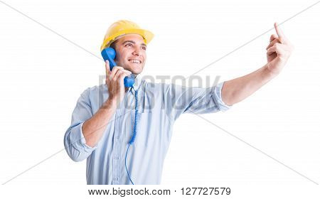 Engineer or architect showing middle finger while talking on the phone
