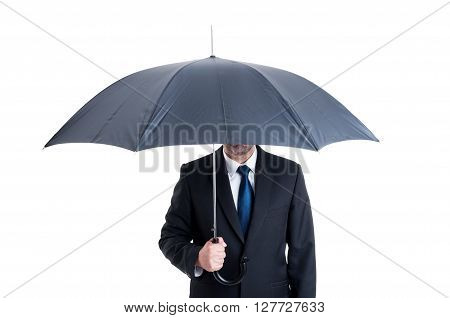 Anonymus business man with an open umbrella. Protection or insurance from financial risk concept