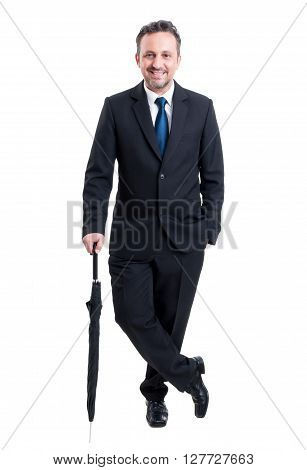 Business man posing with an umbrella full body isolated on white studio background
