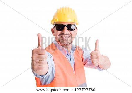 Happy contractor or builder showing thumbsup and wearing shades or sun goggles