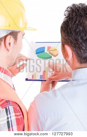 Engineer and builder checking chart pies on clipboard