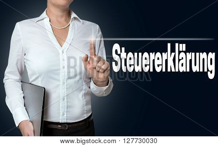 steuererklaerung (in german tax declaration) touchscreen is operated by businesswoman.