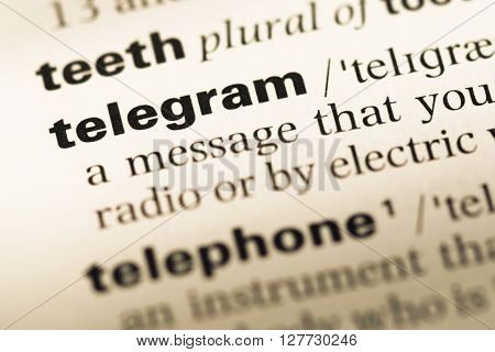 Close Up Of Old English Dictionary Page With Word Telegram.