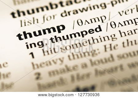 Close Up Of Old English Dictionary Page With Word Thump.
