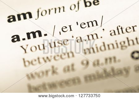 Close Up Of Old English Dictionary Page With Word A.m..