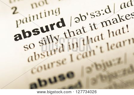 Close Up Of Old English Dictionary Page With Word Absurd.