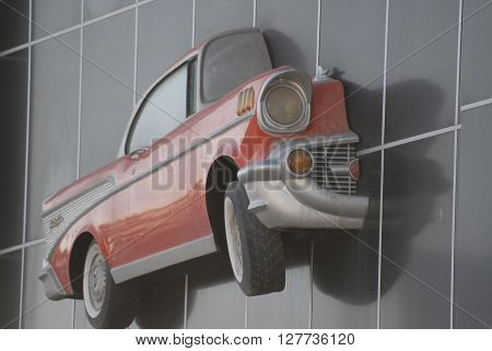 ANKARA/TURKEY-APRIL 28, 2016: Classic Car maquette at the spare part shop's wall of Sasmaz Industrial Zone.April 28, 2016-Ankara/Turkey