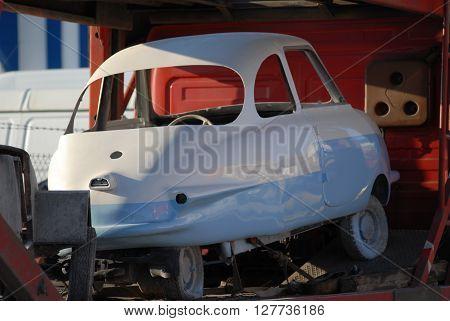 ANKARA/TURKEY-APRIL 28, 2016: Classic vantage tricar on the towing vehicle of Sasmaz Industrial Zone.April 28, 2016-Ankara/Turkey