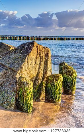 Wooden and rocky groynes on the coastline of the Baltic Sea Germany