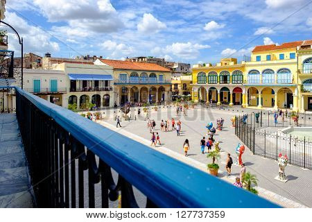 HAVANA,CUBA- APRIL 20,2016 : View of the colorful buildings at the  Old Square from a cononial balcony