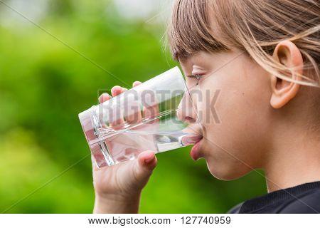 Girl Drinking Glass Of Fresh Water