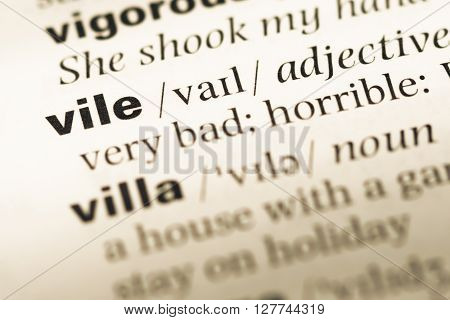 Close Up Of Old English Dictionary Page With Word Vile.