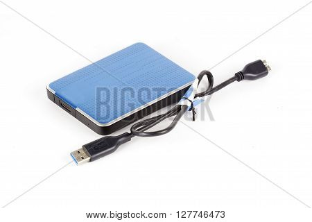 Blue External Hard Drive and cable isolated on white