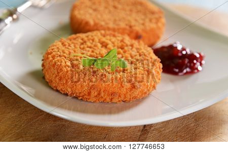 Cutlets stuffed melted  cheesee with cranberry jam