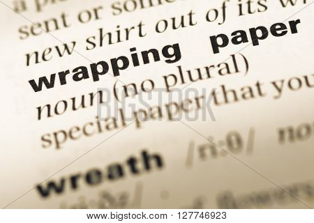 Close Up Of Old English Dictionary Page With Word Wrapping Paper.