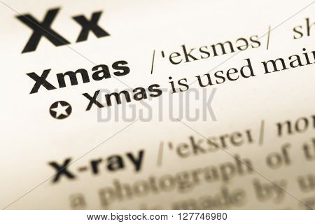 Close Up Of Old English Dictionary Page With Word Xmas.