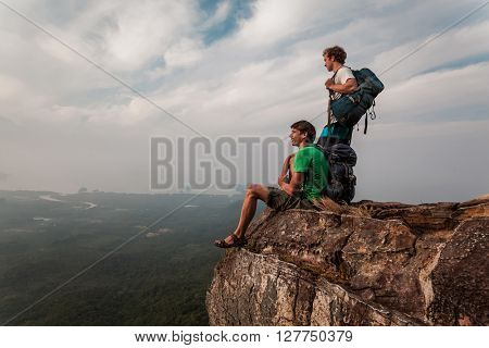 Two men stand on the mountain