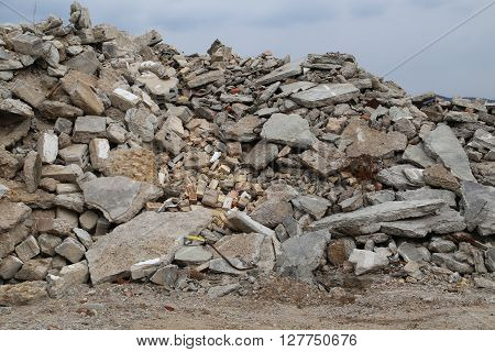 Overlooking a mountain of rubble of a demolished house