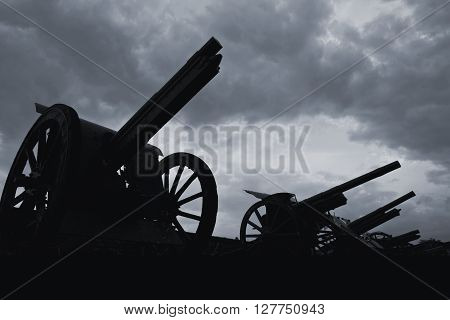 Old cannon silhouettes in the late evening.