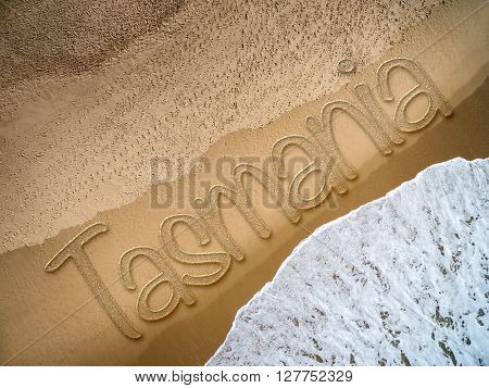 Tasmania written on the beach