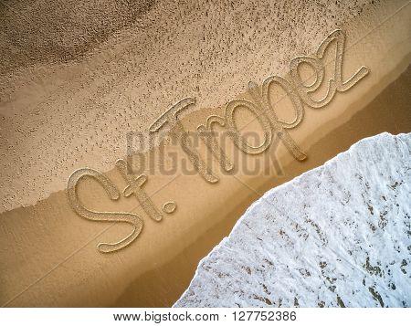 St Tropez written on the beach