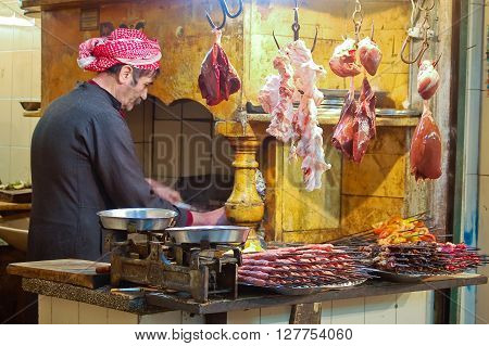 12 february 2007-aleppo-sirya-Butcher who is working his meat to prepare the skewerssirya